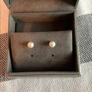 Pearl stud earring with crystal cone back detail